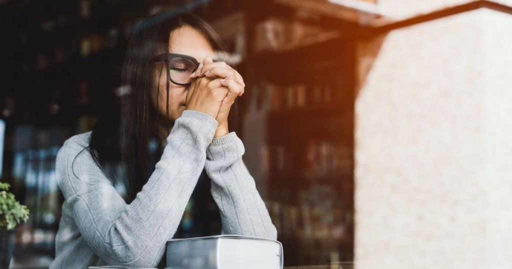 Woman praying prayers for decision making