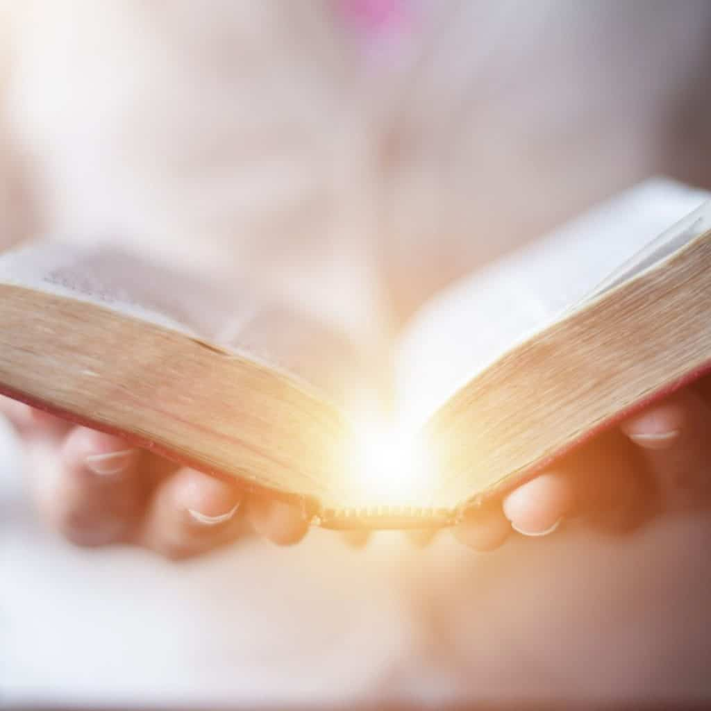 God illuminates an open bible